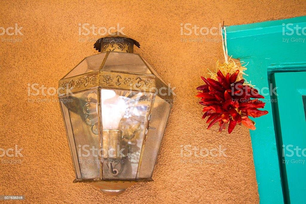 Santa Fe Style: Rustic Turquoise Doorframe, Lamp, Adobe Wall, Ristra stock photo