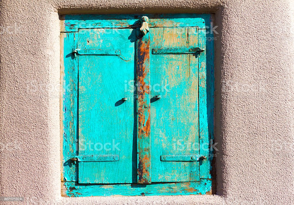 Santa Fe Style: Turquoise Shutters, Adobe Wall stock photo