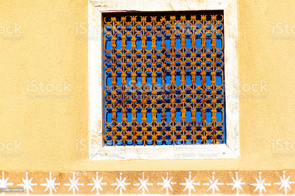 Santa Fe Style: Window and Decorative Yelllow Adobe Wall stock photo