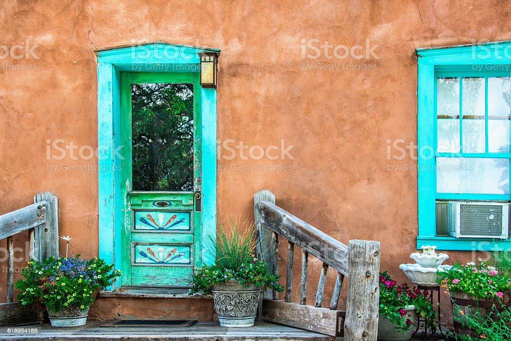 Santa Fe Turquoise Door and Window on Stucco Wall stock photo