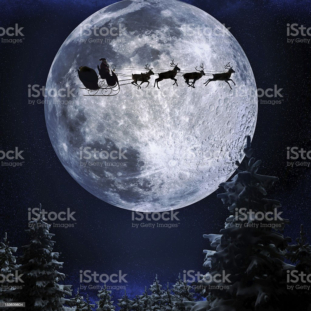 Santa flying over moon stock photo