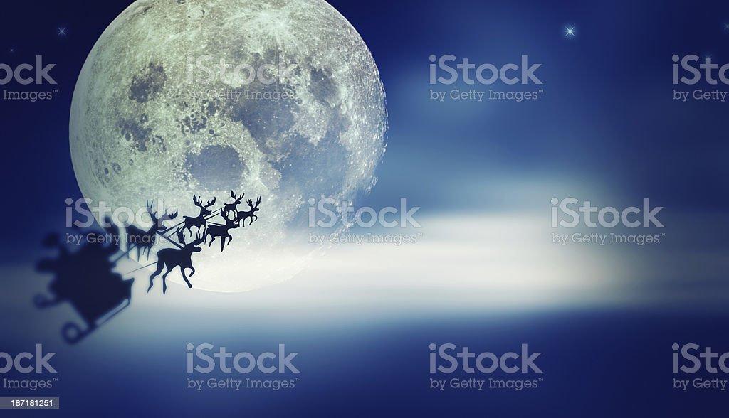 Santa flying over Moon stock photo