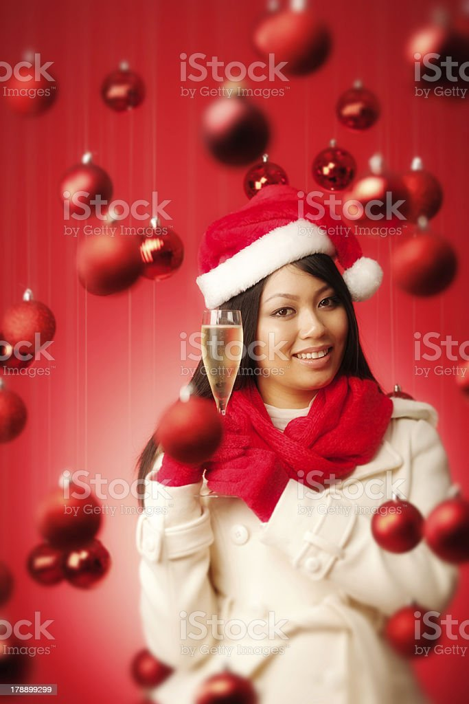 Santa Girl Model Holding Champagne in Christmas Background Vt royalty-free stock photo