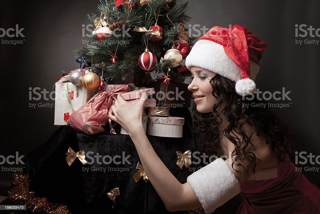 Santa girl open the gift. royalty-free stock photo