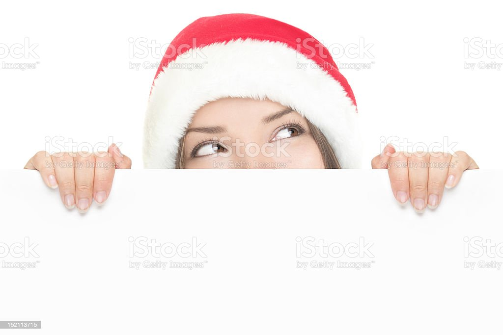 Santa girl peeking over sign board royalty-free stock photo