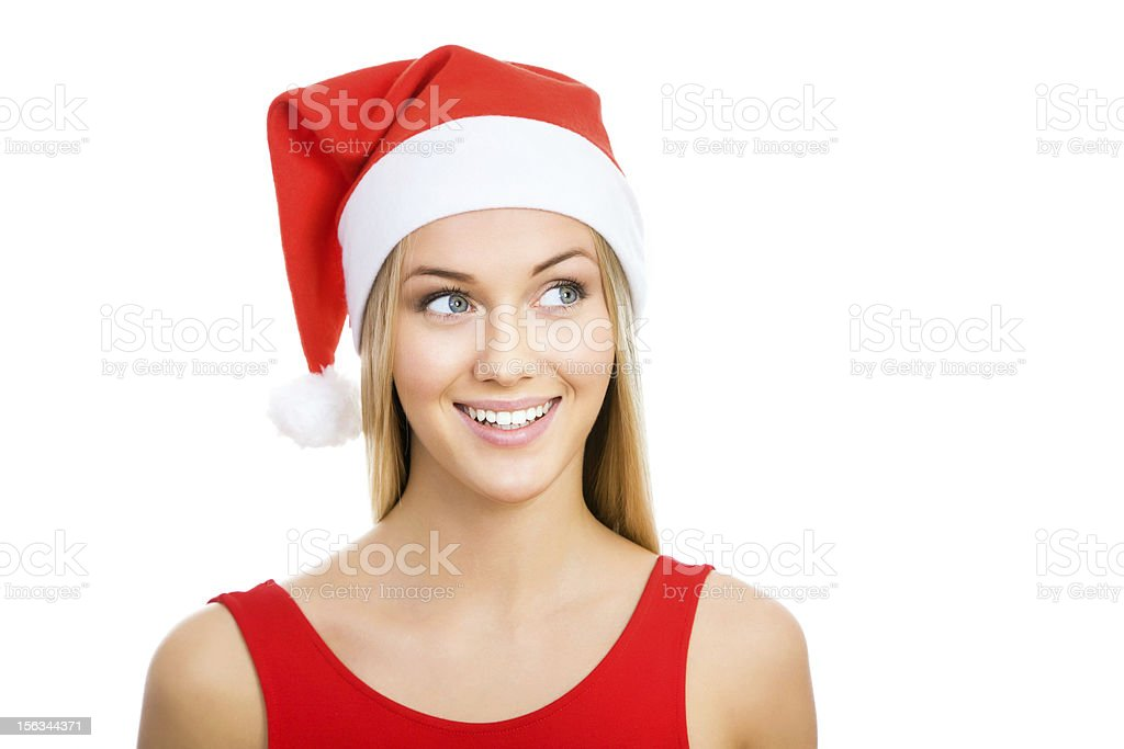 Santa girl shows a white space royalty-free stock photo