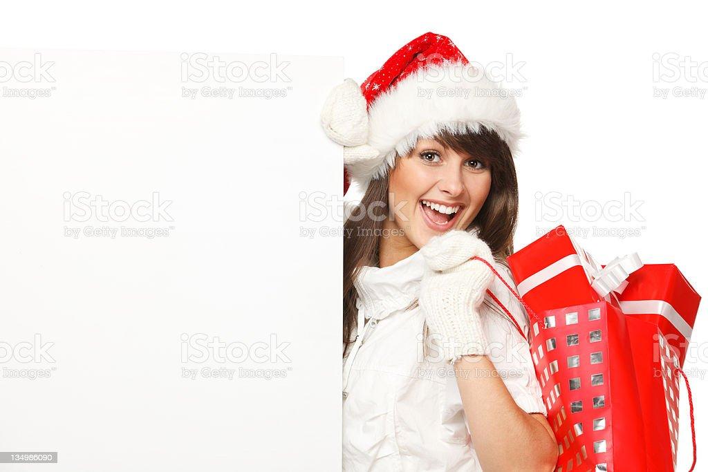 Santa girl with blank billboard royalty-free stock photo