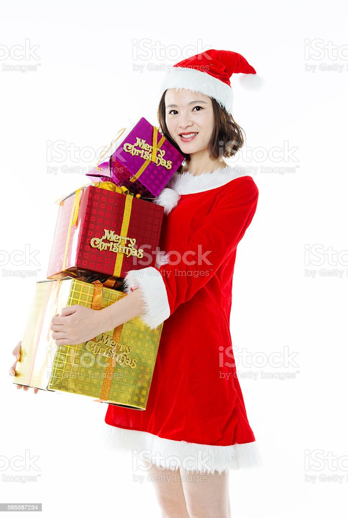Santa girl with christmas gift box stock photo