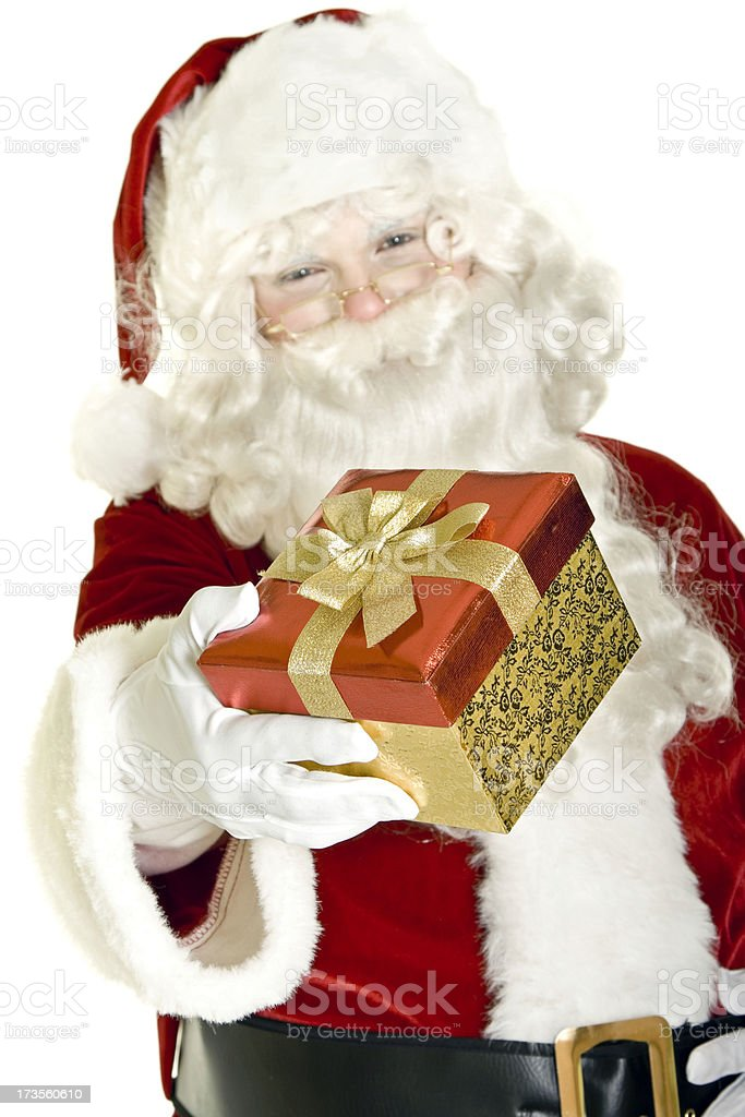 Santa giving a gift isolated on white royalty-free stock photo