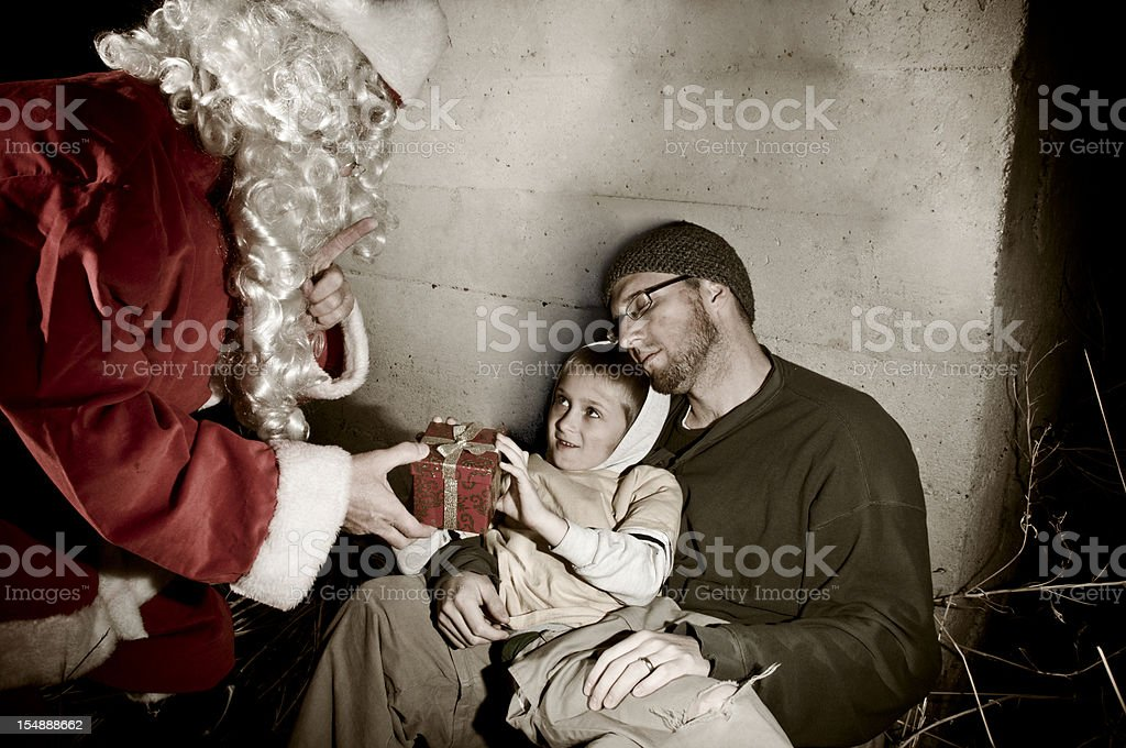 Santa giving to the homeless royalty-free stock photo