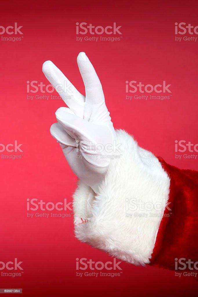 Santa Hands: Peace Sign royalty-free stock photo