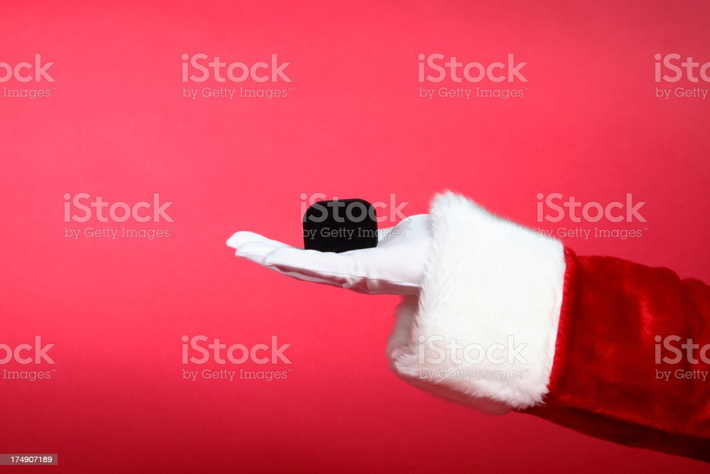 Santa Hands:  St. Nick Brings Romance on Red royalty-free stock photo