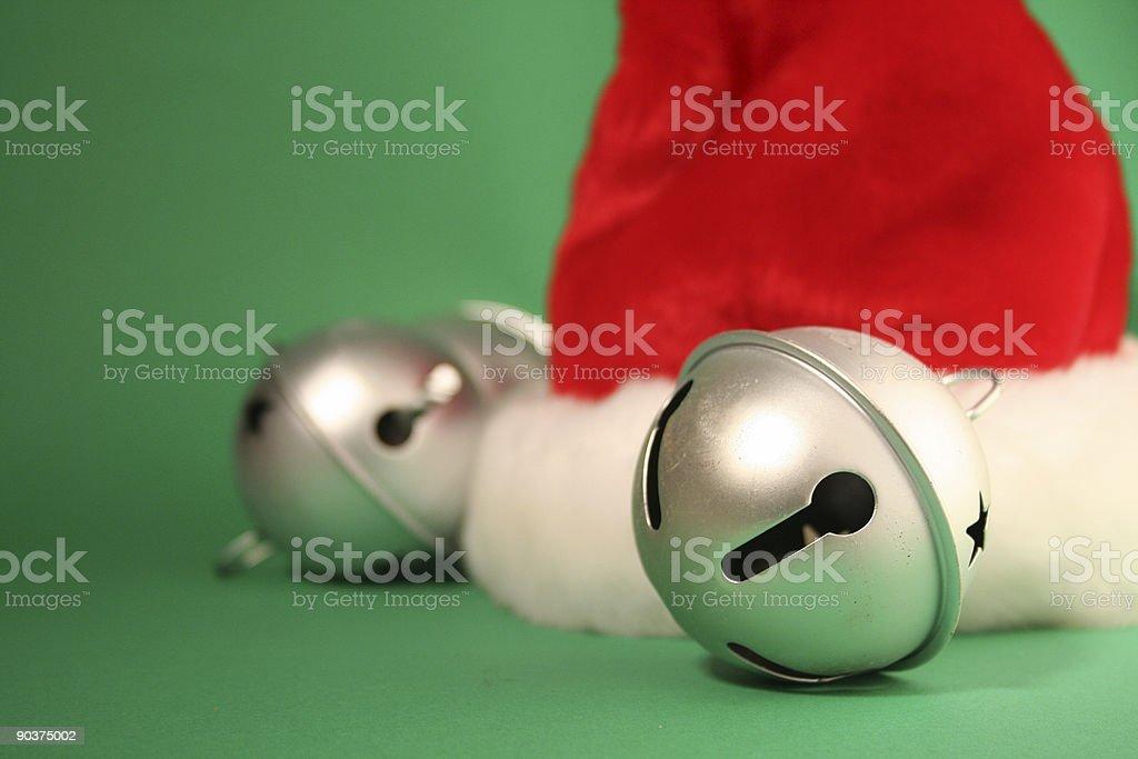 santa hat and jingle bells stock photo