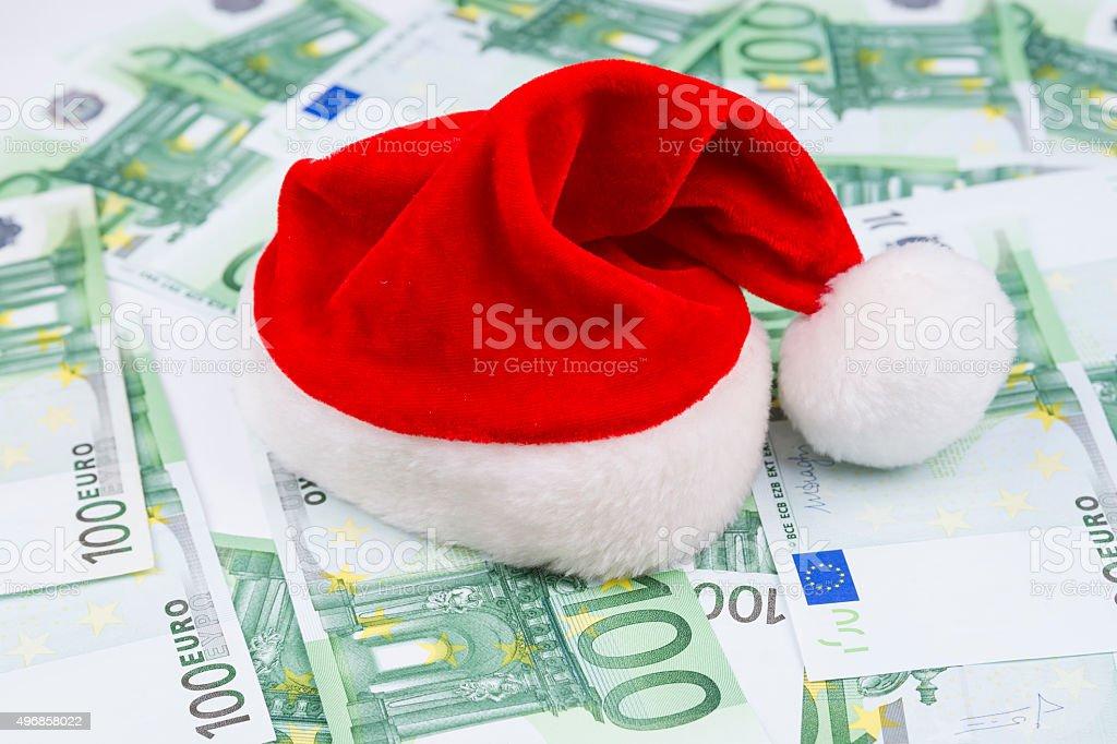 Santa hat and money stock photo