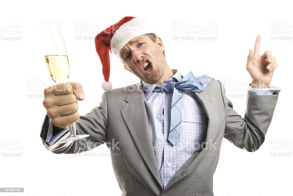 Santa Hat Businessman Toasts the Camera at Christmas Office Party royalty-free stock photo