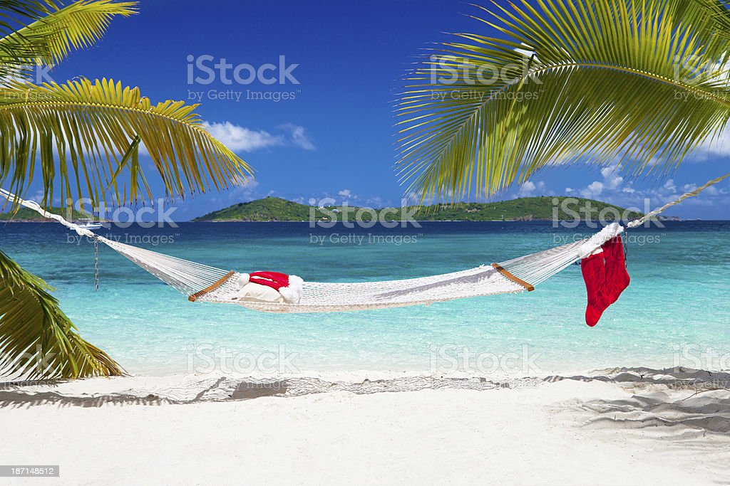 Santa hat, Christmas stockings and a hammock at the beach royalty-free stock photo