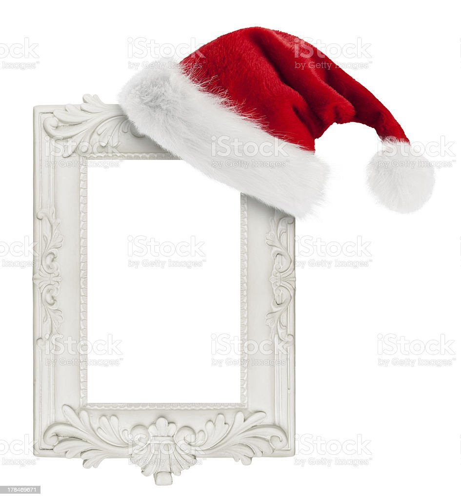 Santa hat hung on the vintage frame stock photo