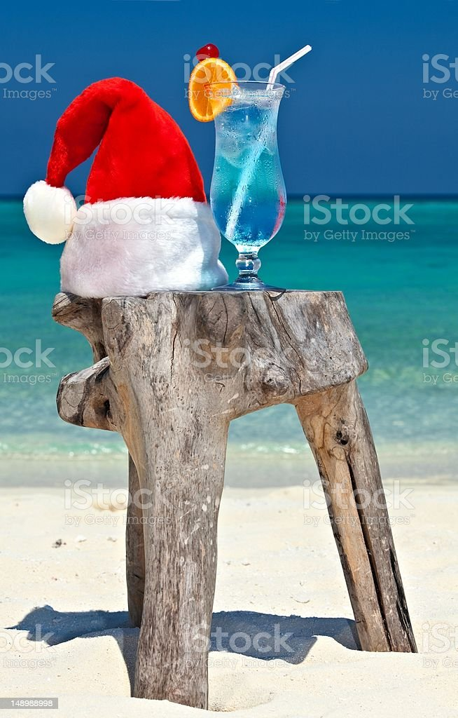 Santa hat is on a beach royalty-free stock photo