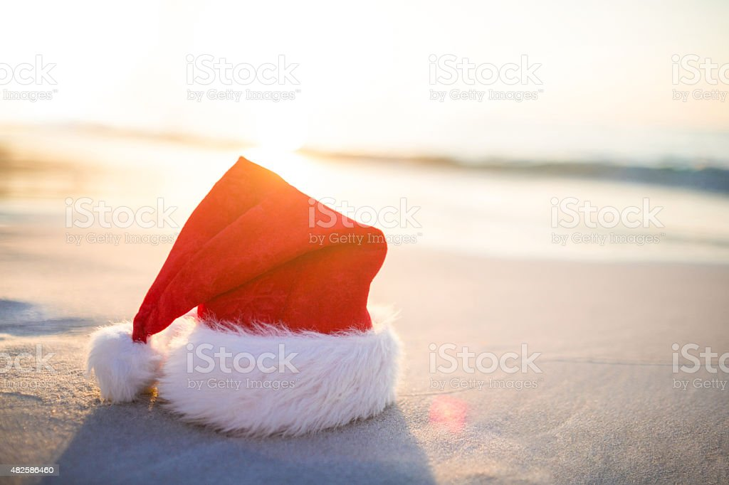 Santa hat on the beach stock photo