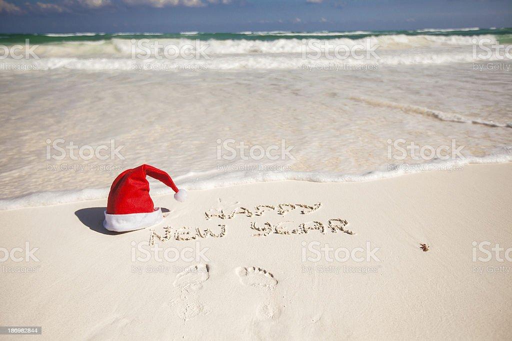 Santa Hat on white sandy beach royalty-free stock photo