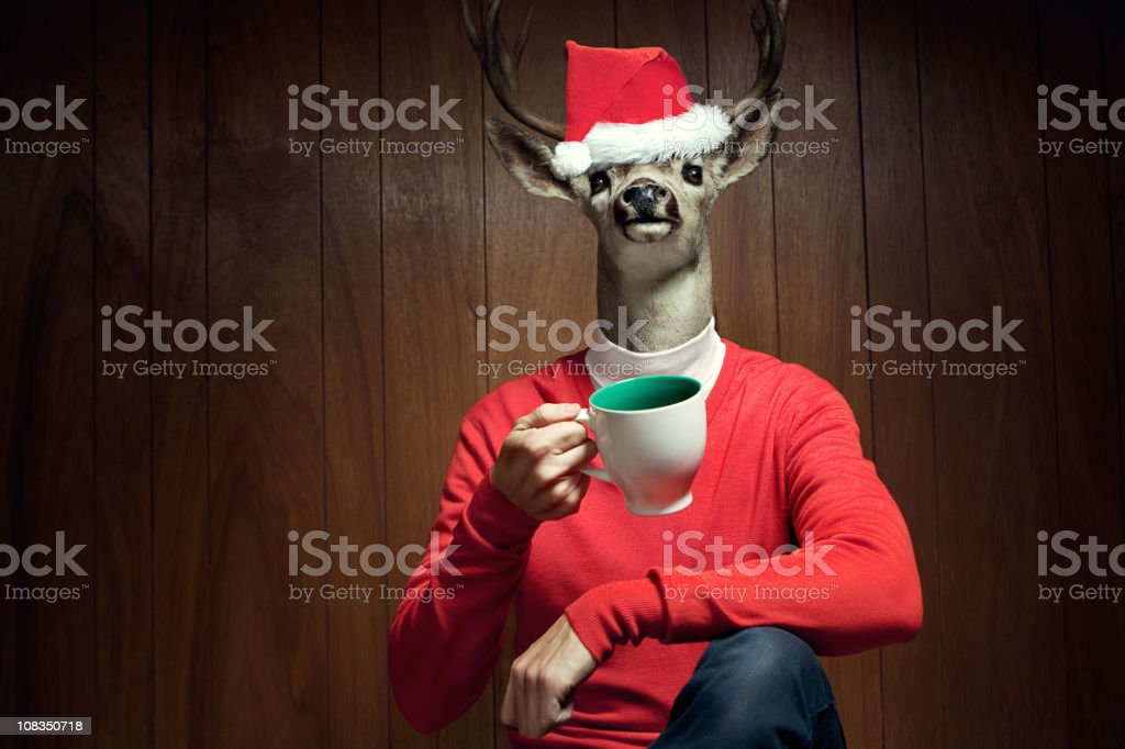 Santa Hat Reindeer Man stock photo