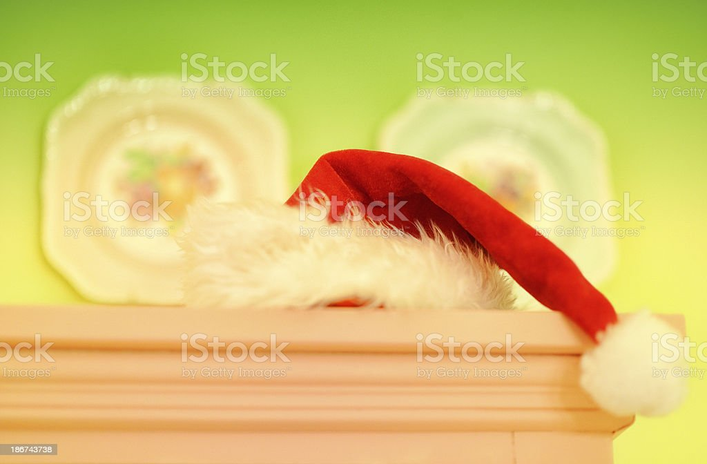 Santa Hat Sitting On Grandma's Fireplace Mantel royalty-free stock photo