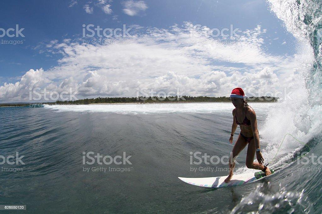 Santa hat surfer bottom turn stock photo
