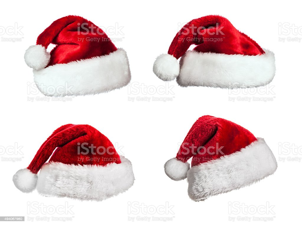 Santa hats on white stock photo
