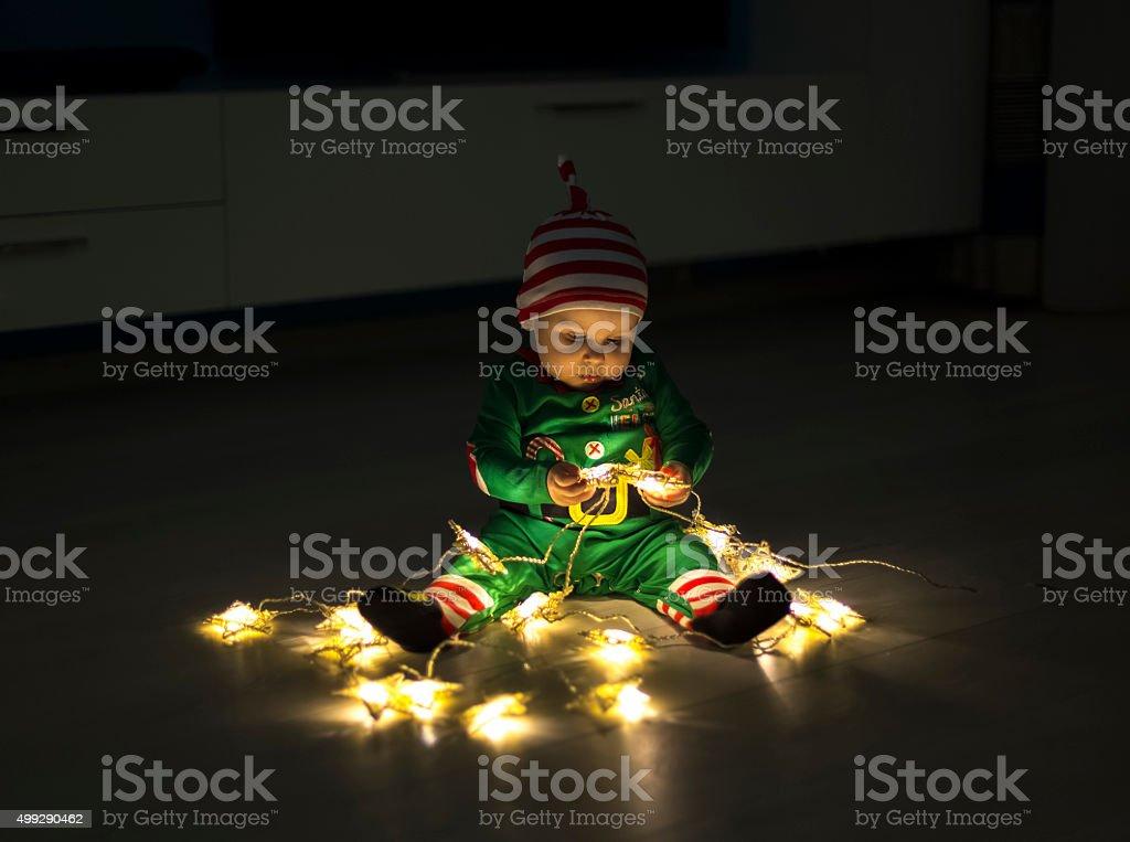 Santa helper baby stock photo