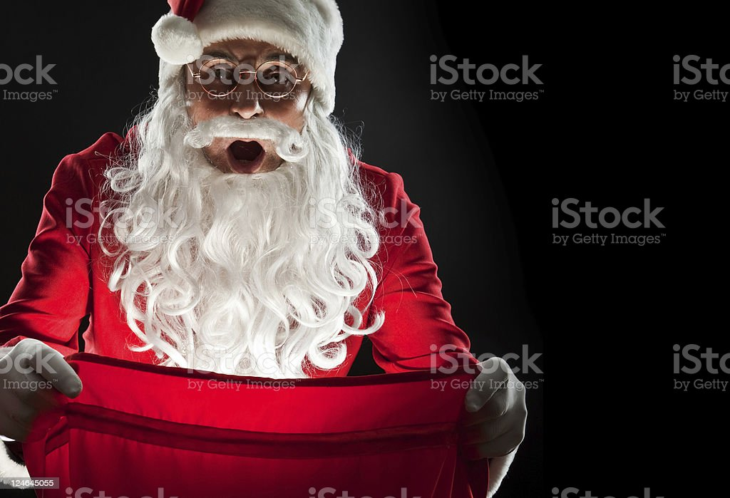 Santa holding a bag of gifts royalty-free stock photo