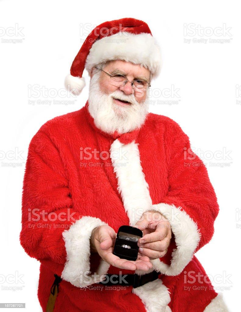 Santa Holding a Diamond Ring royalty-free stock photo