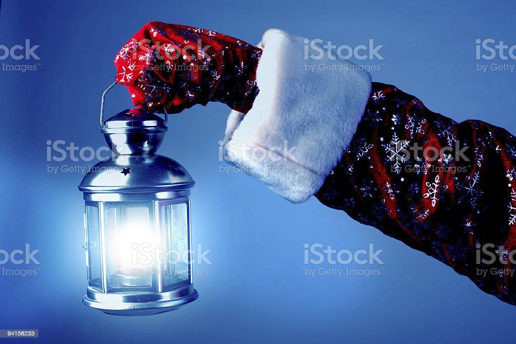 santa holding a lamp royalty-free stock photo