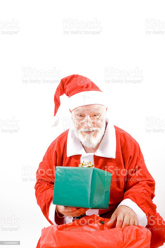 Santa Holding Present With Christmas Sack, Isolated Background royalty-free stock photo