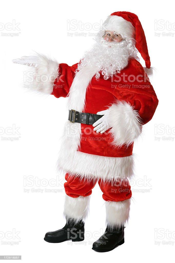Santa holding something (isolated on white) royalty-free stock photo