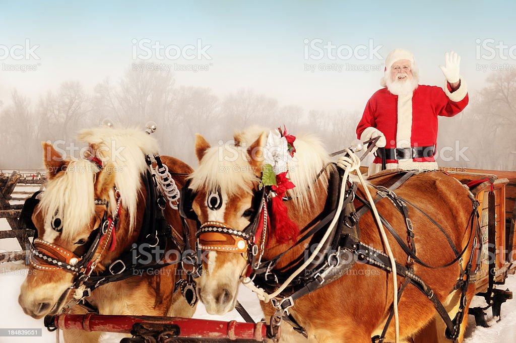 Santa In A Winter Wonderland With His Sleigh And Horses stock photo