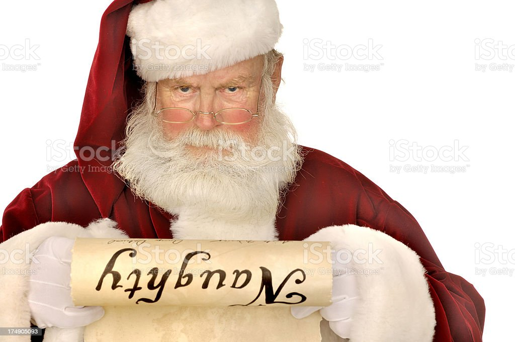 santa looking at naughty list stock photo