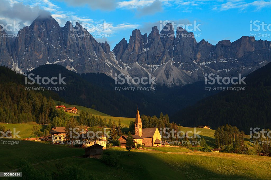 Santa Maddalena village with Odle mountain peaks (Dolomity, Italy). stock photo