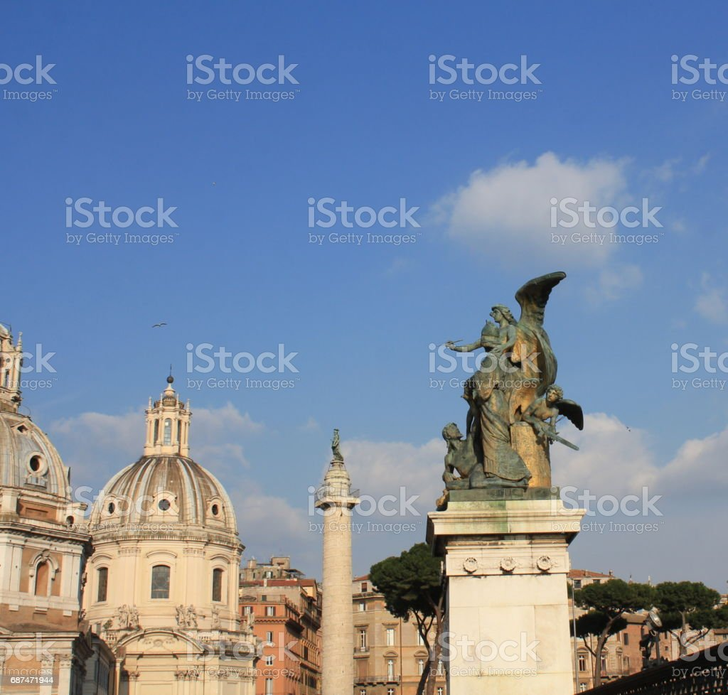 Santa Maria di Loreto church and statue in front of National Monument of Victor Emmanuel II, Rome, Italy stock photo