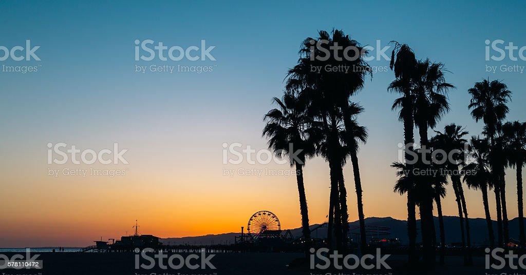 Santa Monica beach and pier at sunset stock photo