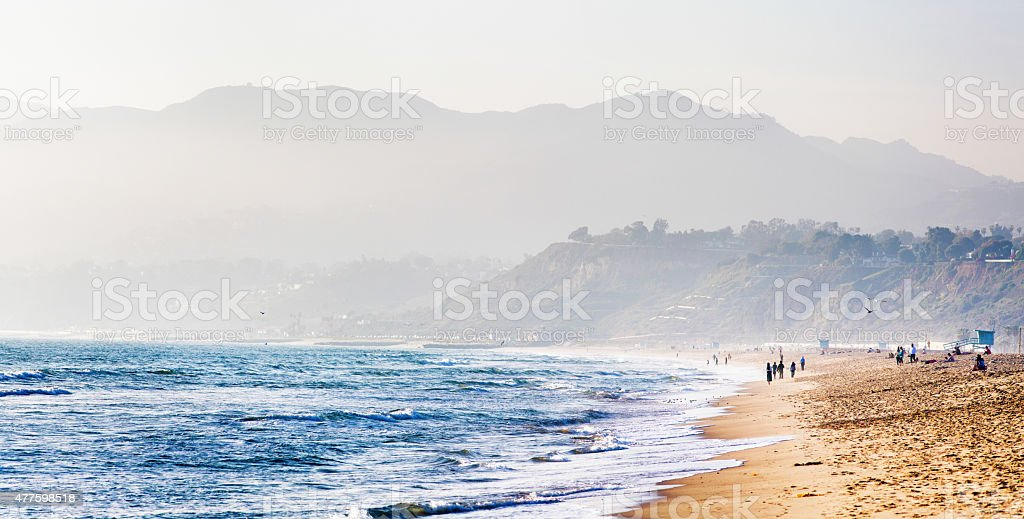 Santa Monica beach on misty evening mountains in background stock photo