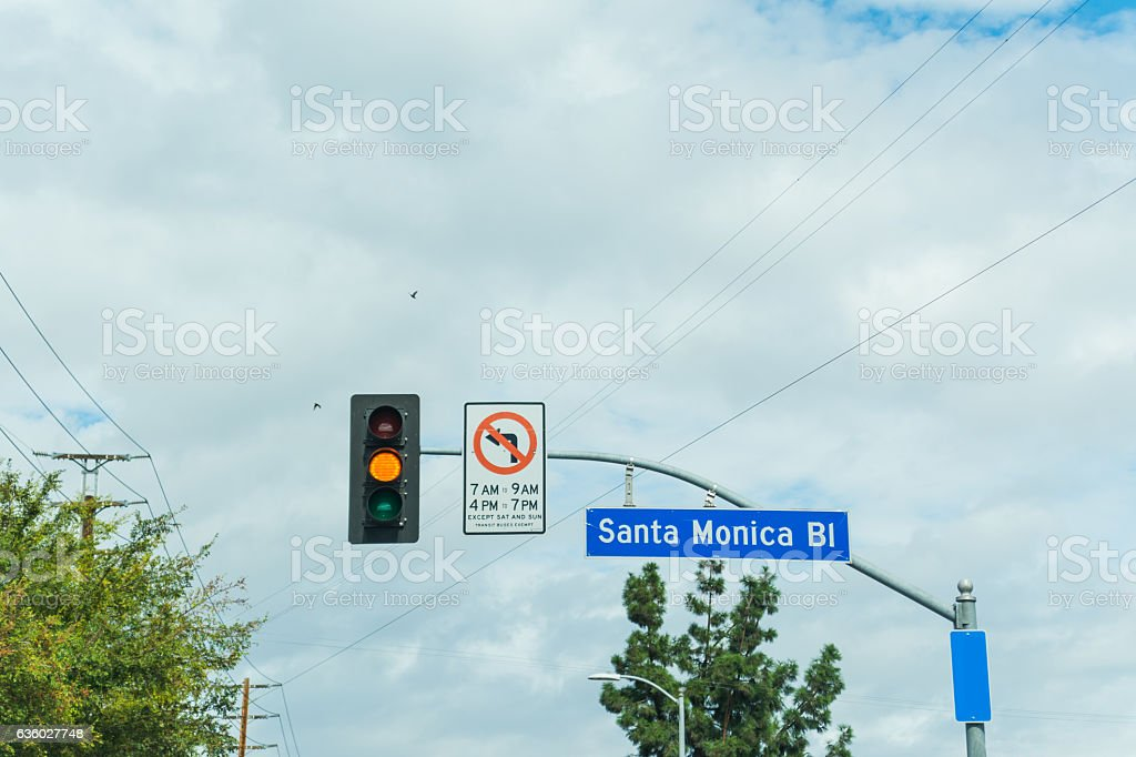 Santa Monica boulevard sign under a cloudy sky stock photo
