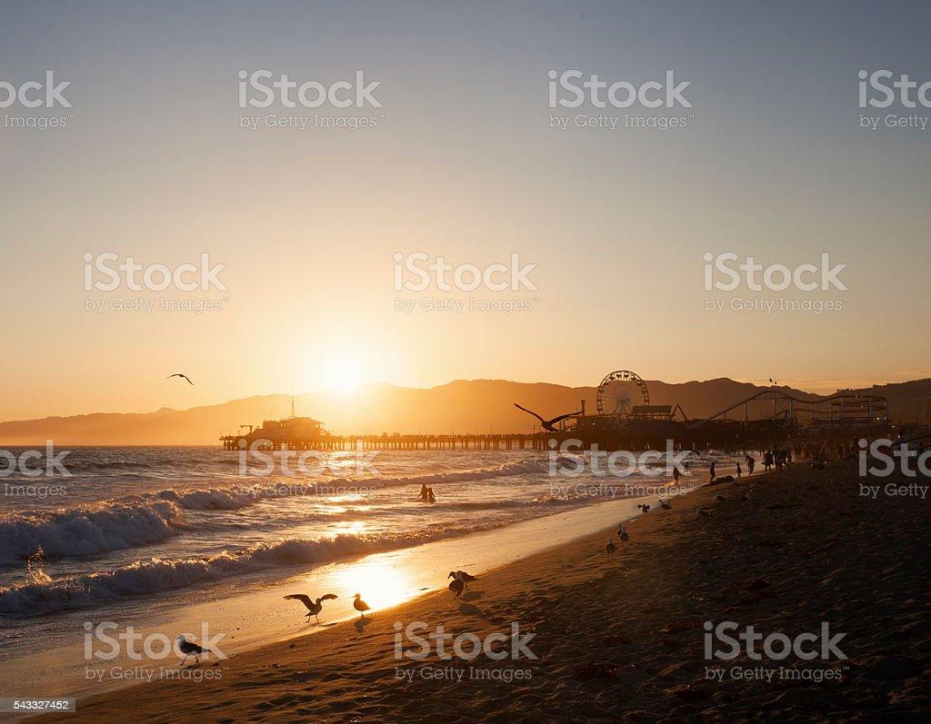 Santa Monica Pier and beach at sunset stock photo
