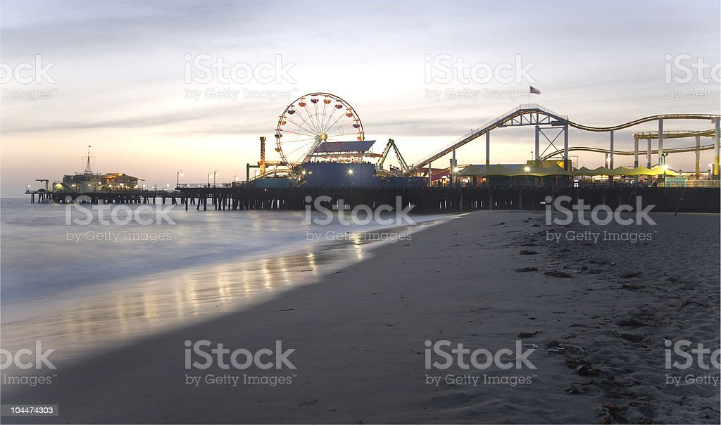 Santa Monica pier at dusk with Ferris wheel and beach stock photo