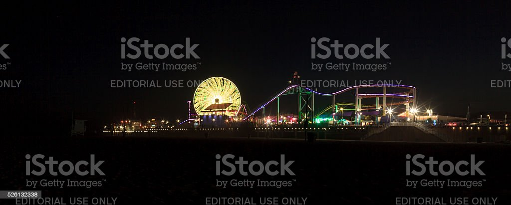 Santa Monica Pier boardwalk lit up at night stock photo
