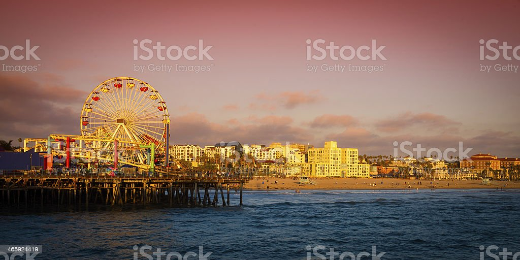 Santa Monica Pier illuminated by the sunset stock photo