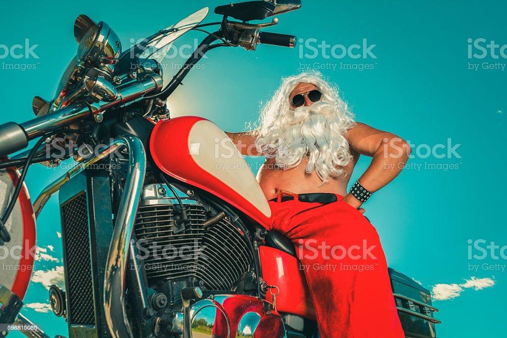 Santa on a motorcycle stock photo