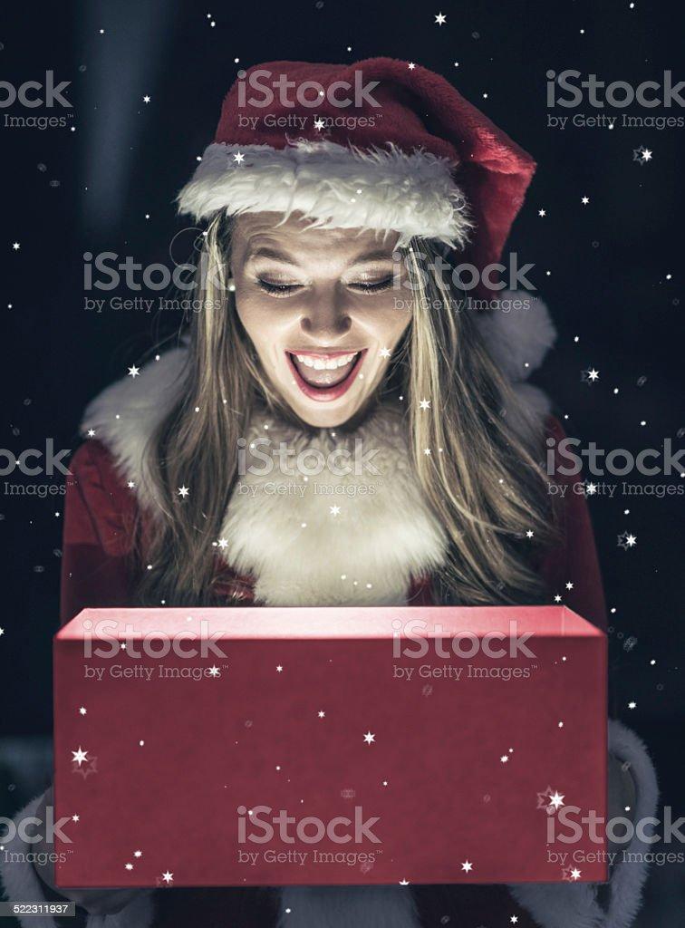 Santa opening a Christmas present stock photo