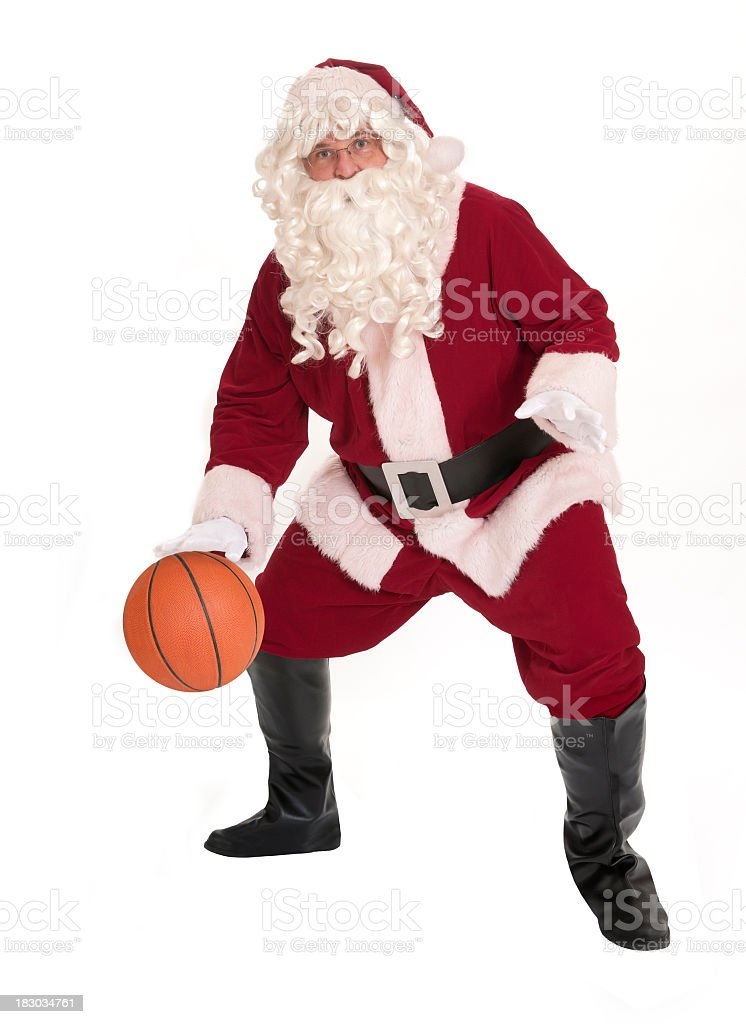 Santa playing basketball on white background royalty-free stock photo