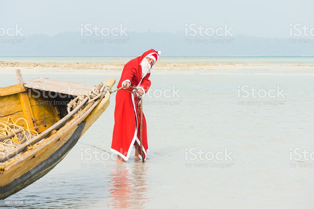 Santa pulling the boat stock photo