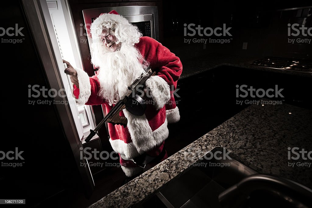 Santa Raiding Refrigerator royalty-free stock photo